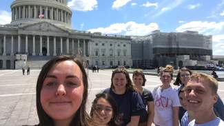 photo of eight students with US capitol building