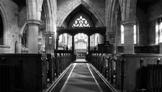 black and white photo of empty church sanctuary