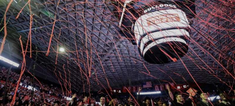 photo of indoor commencement ceremony celebration, with streamers