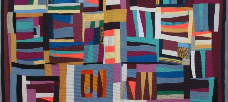 photo of a multi-colored quilt
