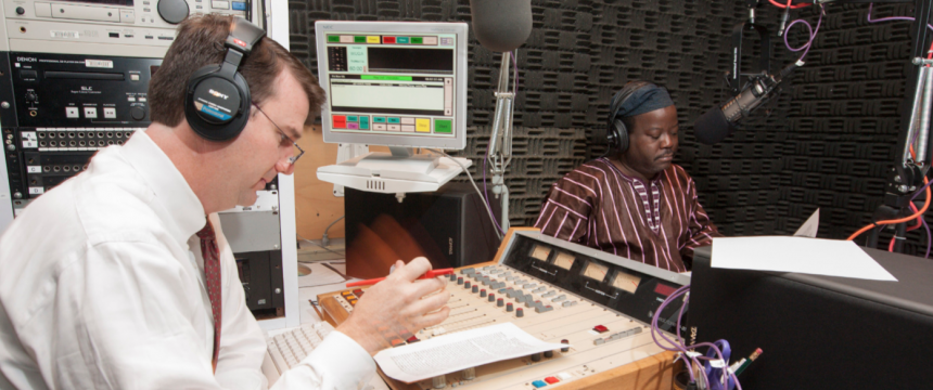 "WUGA operations manager Michael Cardin and ""African Perspectives"" radio show host Akinloye Ojo prepare for the show's 10 year anniversary broadcast."