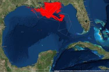 satellite photo of Gulf of Mexico, with red spill outline