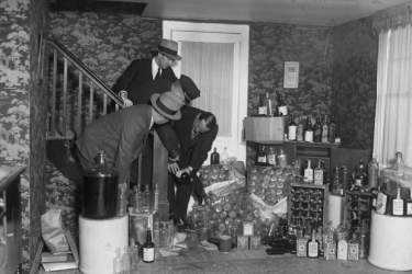 black and white archival image of alcohol hoarding