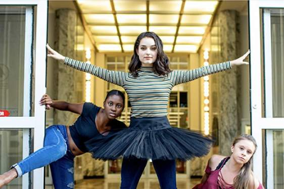 photo of four dancers posed at the library door