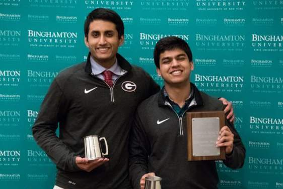 two students with plaque and cups
