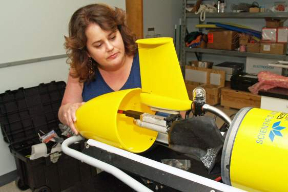 photo of woman with underwater robotic glider