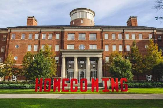 photo of building with large red letters spelling homecoming