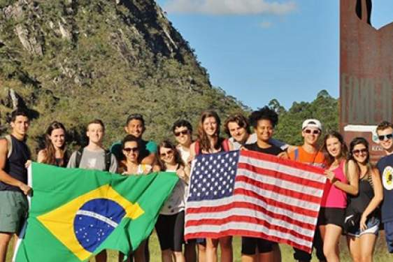 photo of students holding Brazilian and American flags