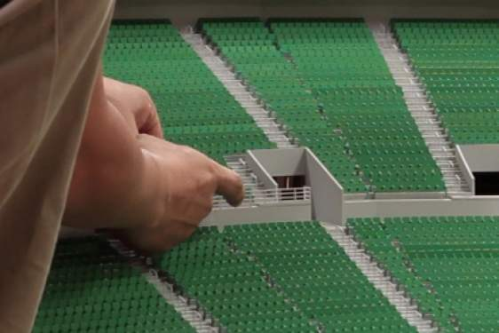 stadium sculpture in miniature, with hand