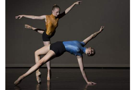 photo of two ballet dancers on stage