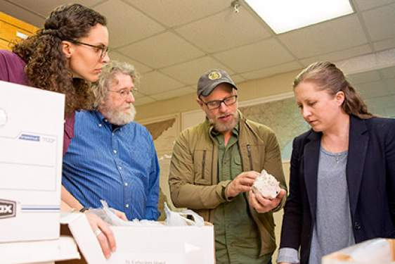 four people with shell, interior photo