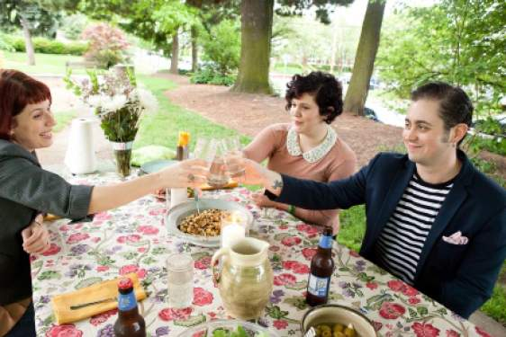 three people at a picnic, photo