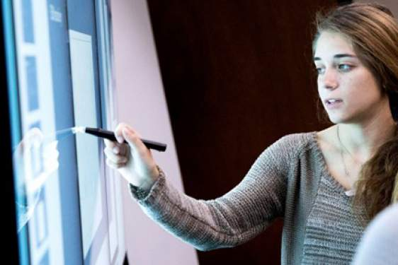 woman at smart board, photo