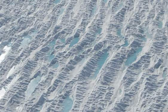 aerial photo of water puddles on glacier