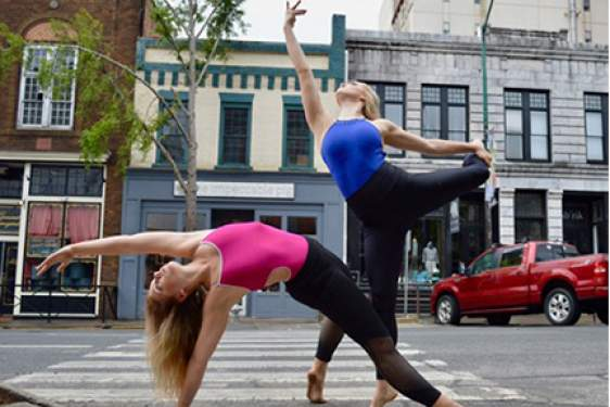 dancers posed on a street